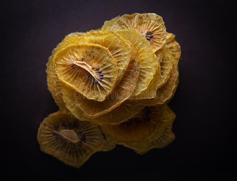 Dried golden kiwi fruit slices stock photos