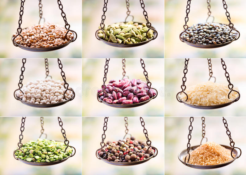 Dried grains, seed and beans in balance scale stock photos