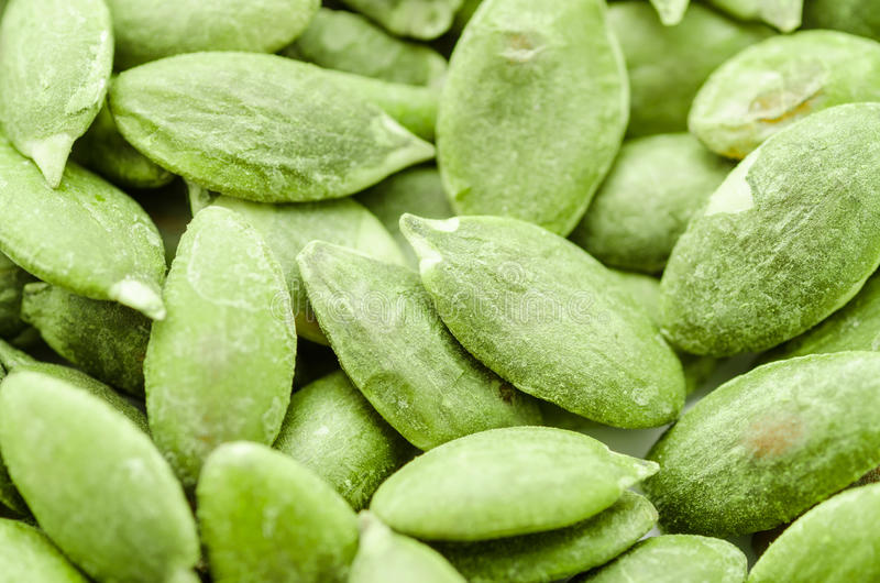 Dried green pumpkin seeds. Macro background texture of dried green pumpkin seeds stock images