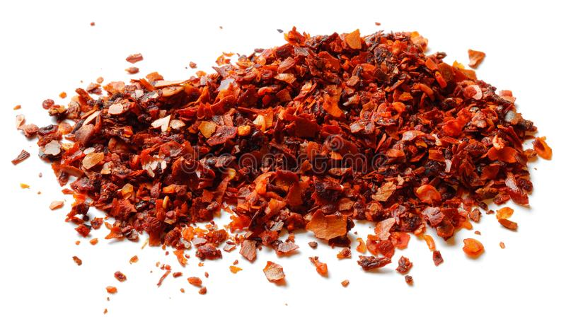 Dried ground red pepper and seeds isolated. On white background royalty free stock photo