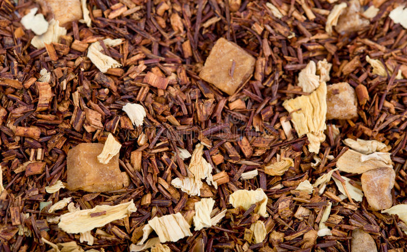 Dried herbal tea with fruit pieces stock photos