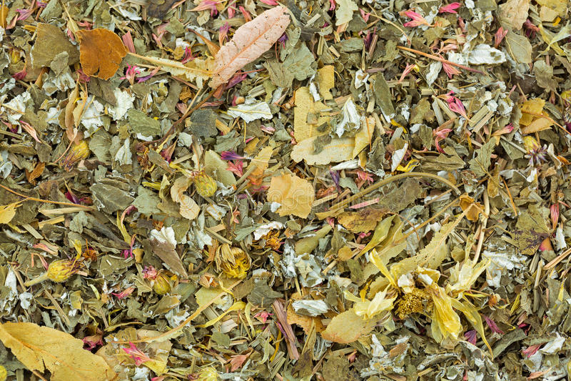 Dried herbal tea with lemon balm, rose petal, marigold, cornflower, blackberry, lemongrass leaves. Closeup of dried fruity herbal tea with lemon balm, rose petal royalty free stock image
