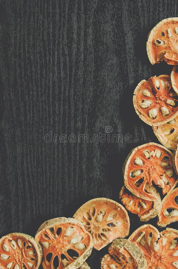 Dried herbs and dried bael fruit, Top view of bael dry on the wooden floor, stock photo