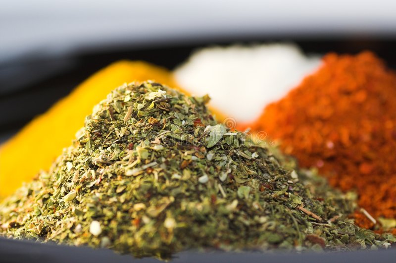 Dried herbs, curry, chili stock photos