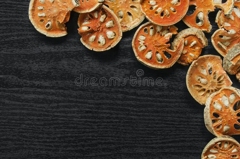 Dried herbs and dried bael fruit, Top view of bael dry on the wooden floor royalty free stock images