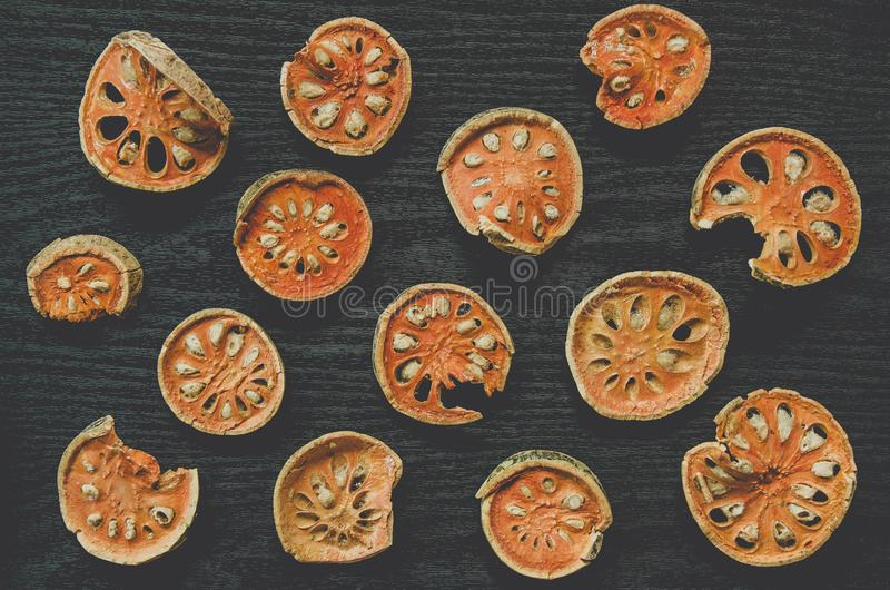 Dried herbs and dried bael fruit, Top view of bael dry on the wooden floor stock images