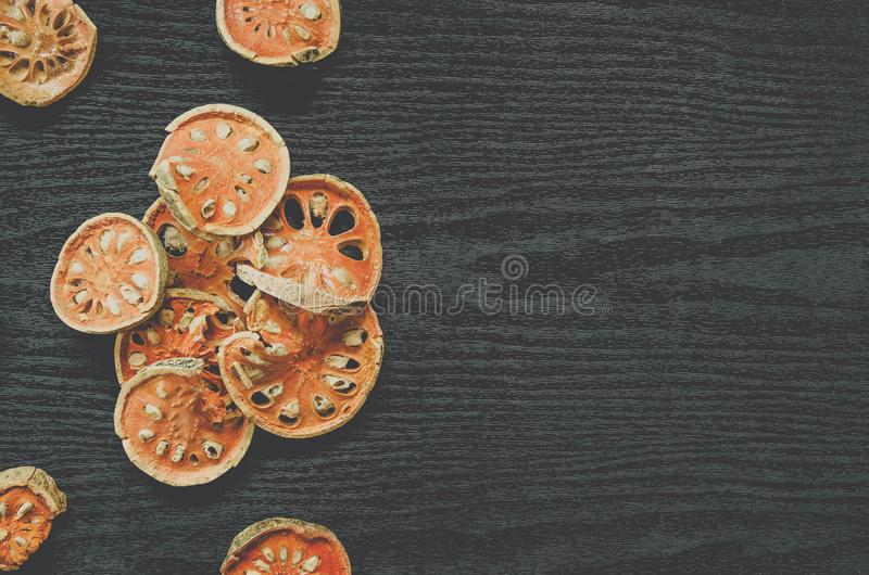 Dried herbs and dried bael fruit, Top view of bael dry on the wooden floor stock photography
