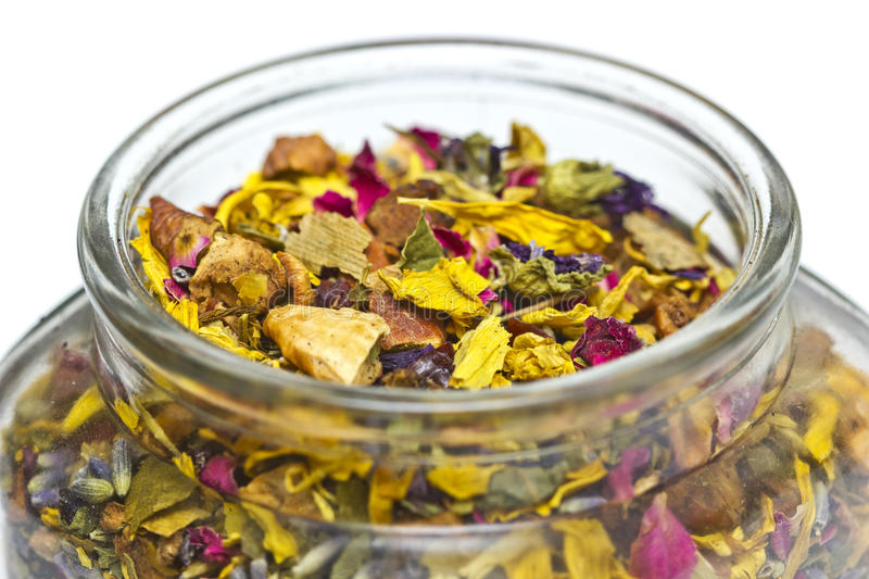 Dried Herbs and Flowers in a Jar. Dried herbs and flowers jar stock photo