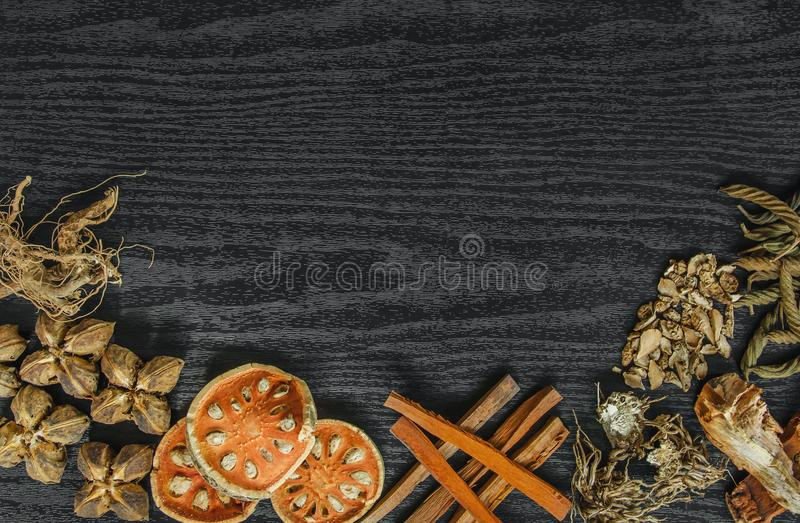 Dried herbs and Ginseng, Top view of Thai herbs and ginseng on wooden floor royalty free stock photo