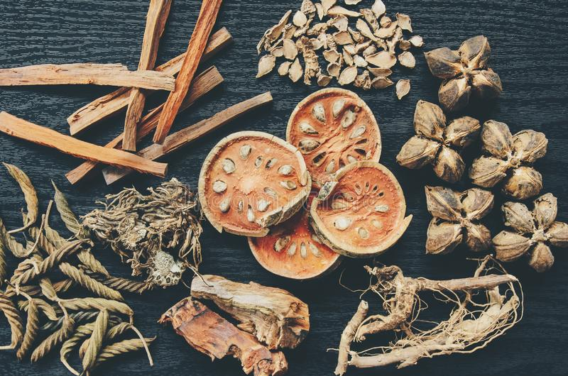 Dried herbs and Ginseng, Top view of Thai herbs and ginseng on wooden floor stock images
