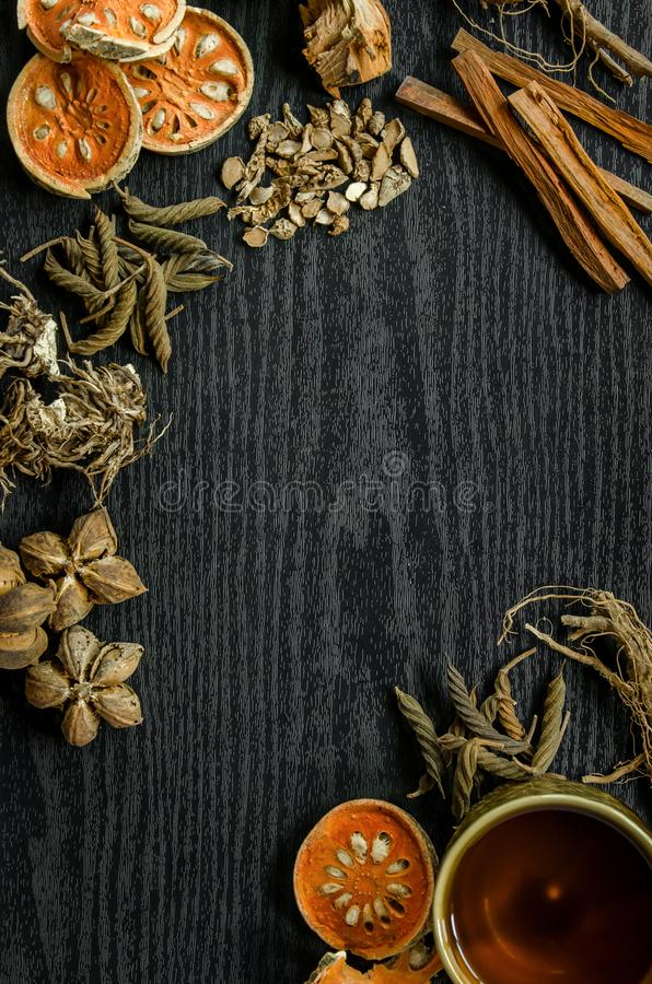 Dried herbs and Ginseng, Top view of Thai herbs and ginseng on wooden floor stock photography