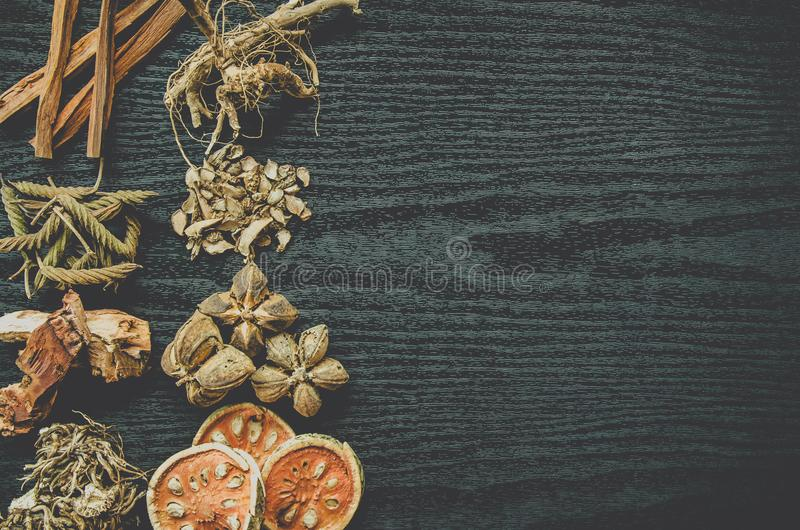 Dried herbs and Ginseng, Top view of Thai herbs and ginseng on wooden floor royalty free stock photography