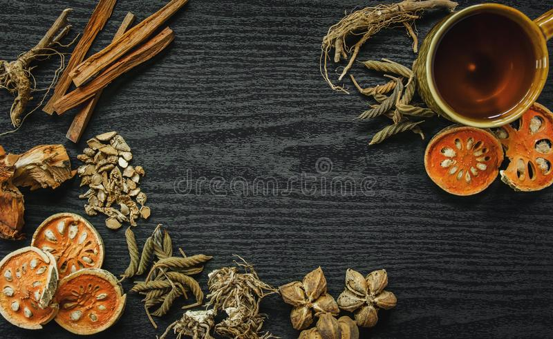 Dried herbs and Ginseng, Top view of Thai herbs and ginseng on wooden floor royalty free stock image