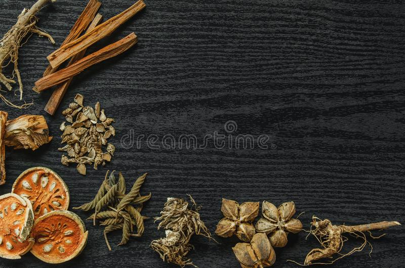 Dried herbs and Ginseng, Top view of Thai herbs and ginseng on wooden floor royalty free stock images