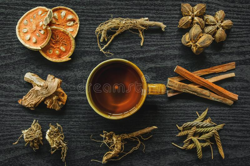Dried herbs and Ginseng, Top view of Thai herbs and ginseng on wooden floor stock photo