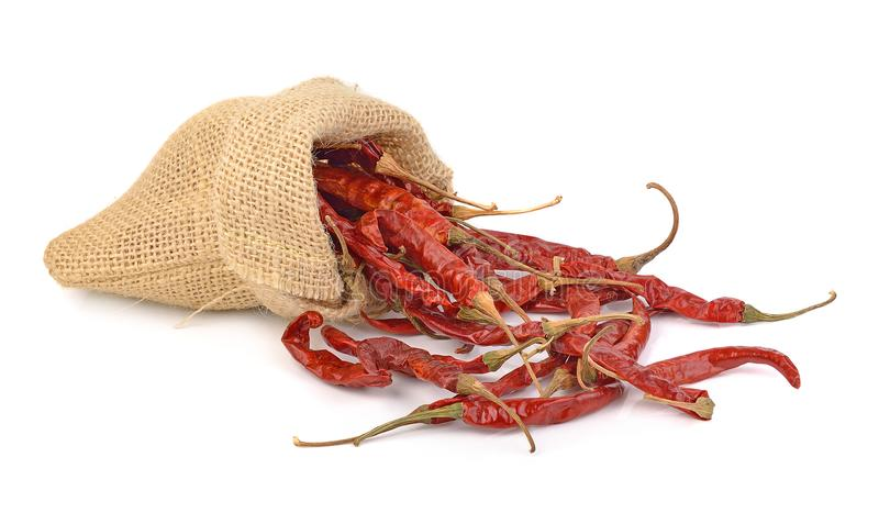 Dried hot red chillies in a sack on white backgroud royalty free stock photo