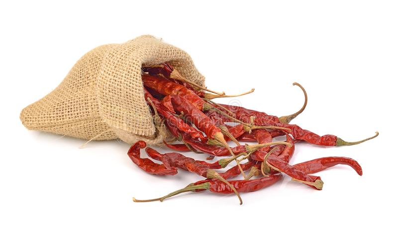 Dried hot red chillies in a sack on white backgroud royalty free stock image