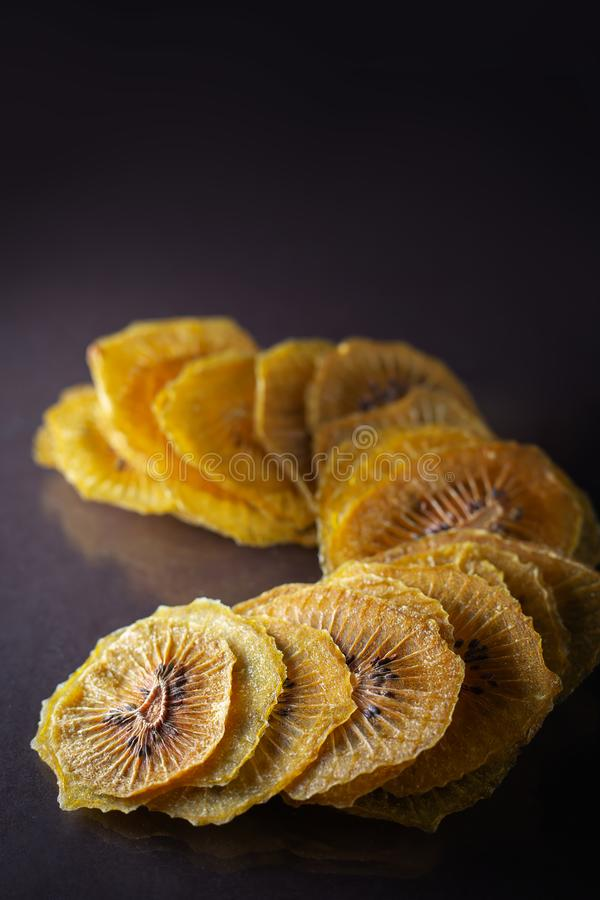 Dried kiwi slices. On black background royalty free stock photography