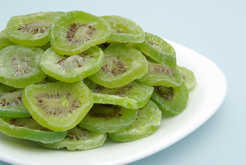 DRIED KIWI SLICES. On a plate stock photos