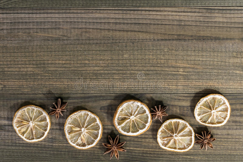 Dried lemon slices with star anise on wooden table. stock photography