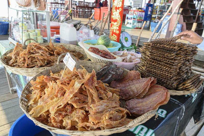 Dried meat, snake, Crocodile, and fish in sale at one of the stilt shop that exist on the lake, as part of the floating village. Cambodia, Tonle-Sap - March 2016 stock images