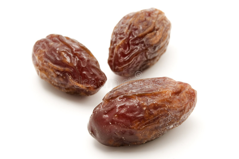 Dried Medjool dates. On a white background royalty free stock images