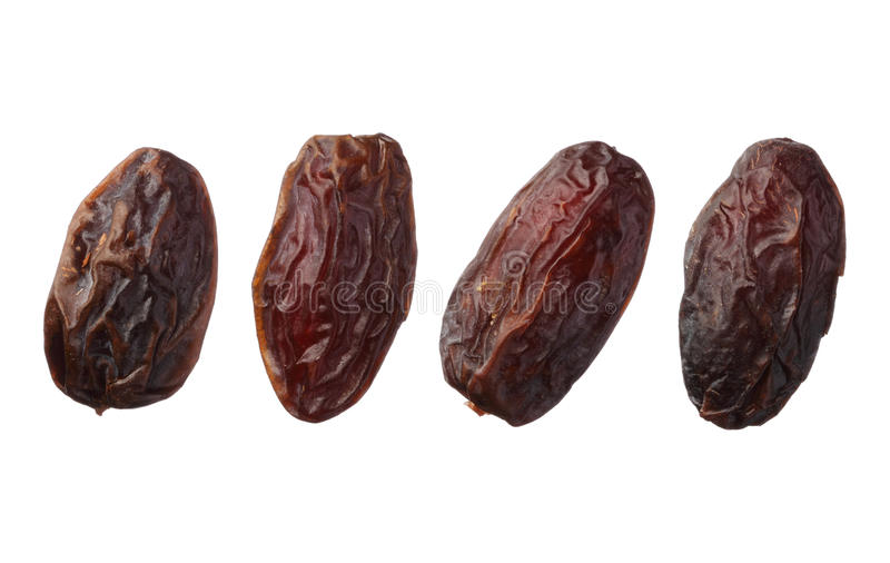 Dried medjool dates isolated on white background. Dried medjool dates isolated on white royalty free stock image