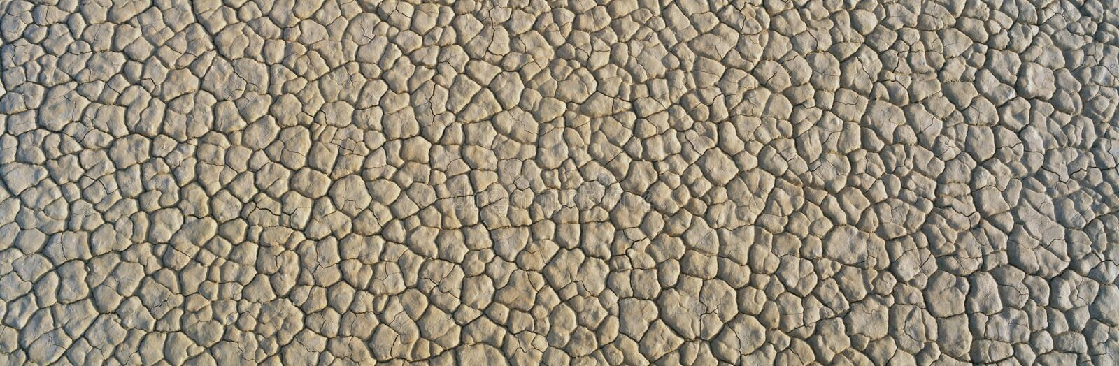 Dried mud in Death Valley National Park. This is the cracked and dry mud from a dried lake. It forms a pattern. This is located in Death Valley National Park stock image