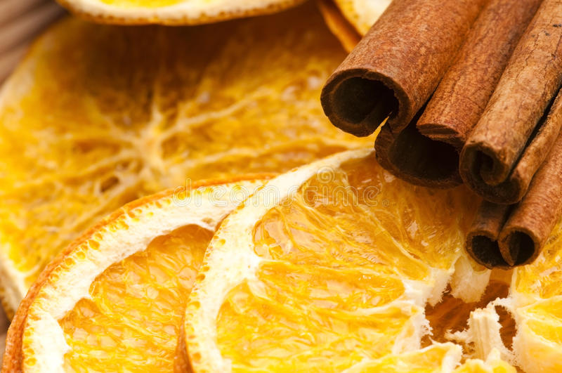 Dried orange and cinnamon sticks royalty free stock images