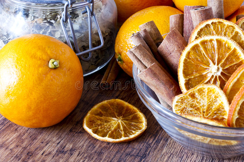 Dried orange and cinnamon sticks - christmas decoration royalty free stock photos
