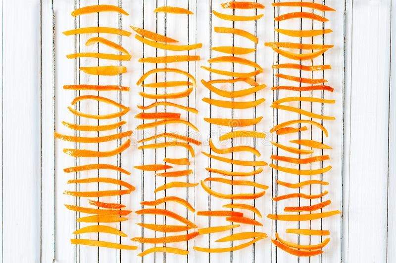 Dried orange peel on the grill. Top view. Sweet candied fruits royalty free illustration