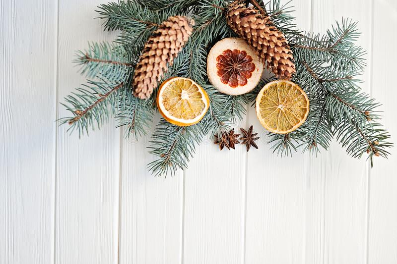 dried orange slices, fir cones on spruce branches on wooden background. top view. Christmas or New Year card stock photos