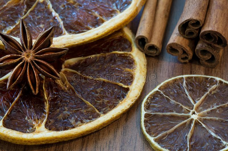 Dried orange slices and dried lemon slice with cinnamon sticks a stock image