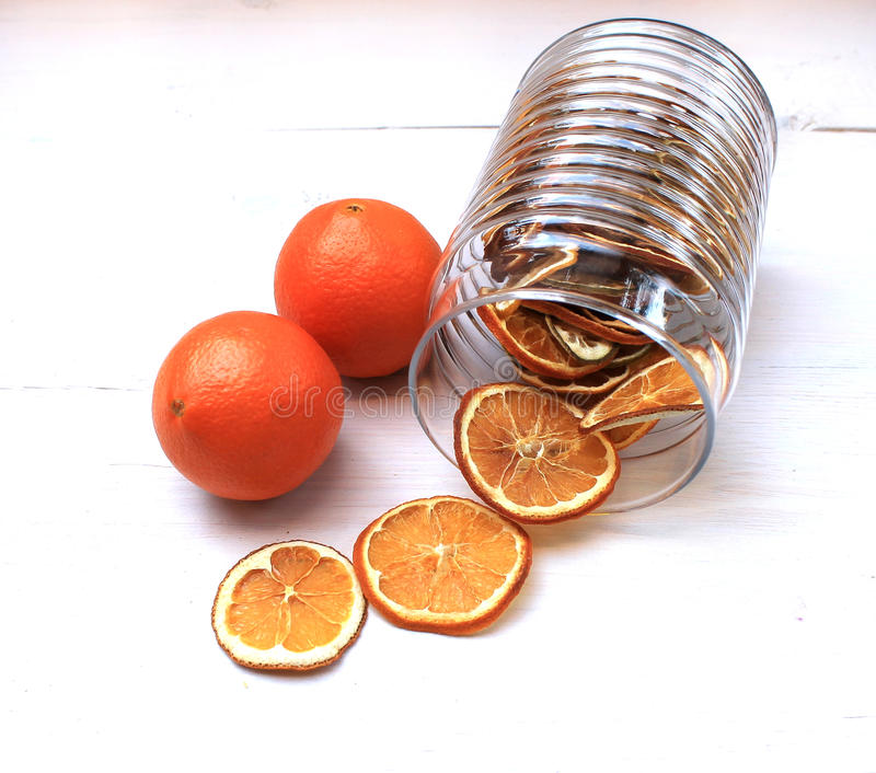 Dried orange slices on the table. And fresh fruits royalty free stock photo