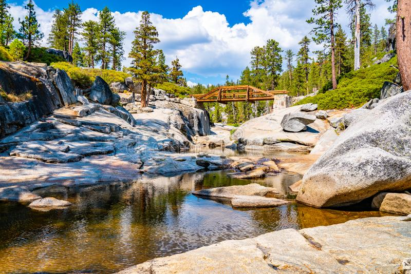 Dried out Yosemite waterfall with small river and pond where used to be mighty falls. stock photos