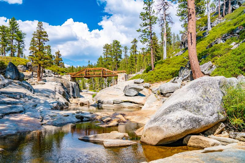 Dried out Yosemite waterfall with small river and pond where used to be mighty falls. royalty free stock photo