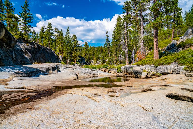 Dried out Yosemite waterfall with small river and pond where used to be mighty falls. royalty free stock photography