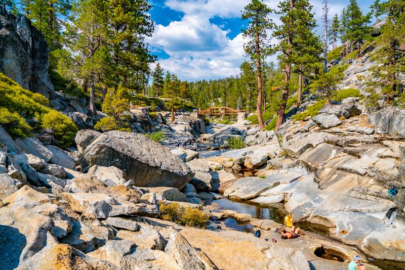 Dried out Yosemite waterfall with small river and pond where used to be mighty falls. stock photo