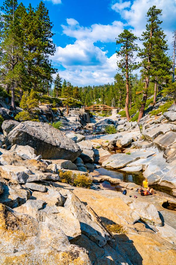 Dried out Yosemite waterfall with small river and pond where used to be mighty falls. stock image