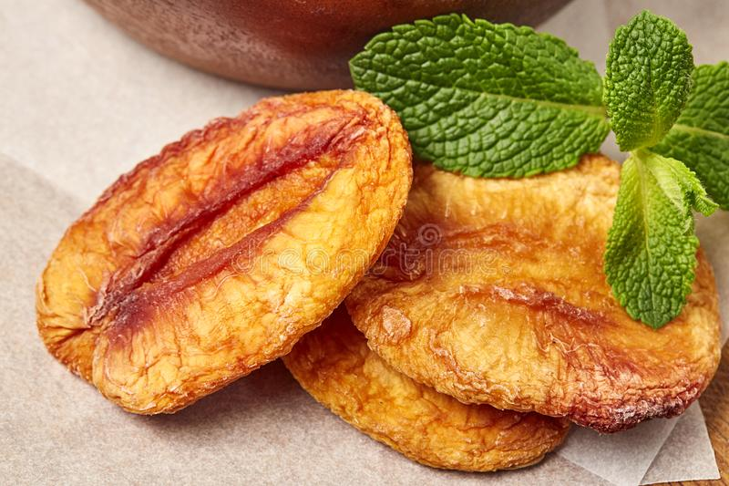 Dried peach with green leaf. Close up stock photos