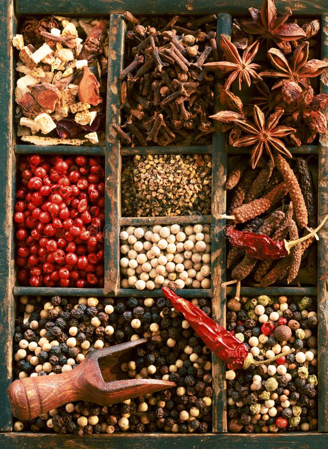 Dried peppercorns, star anise and cloves. Close up overhead view of a selection of different dried peppercorns including white, black and pink, whole chilli stock photos