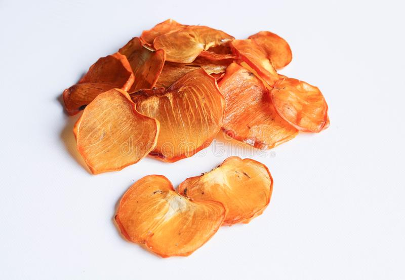 Dried persimmon or kaki fruit slices isolated on white stock image