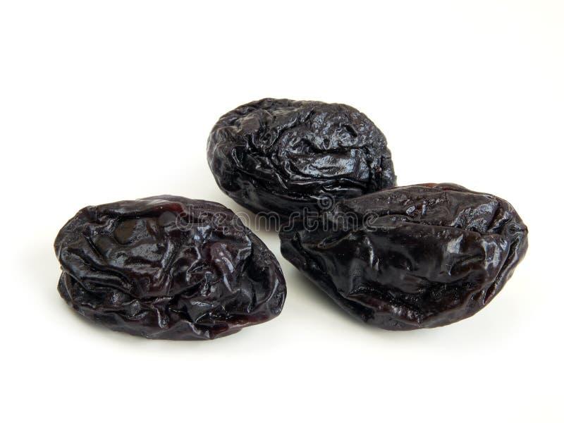 Dried plum. On white closeup stock image