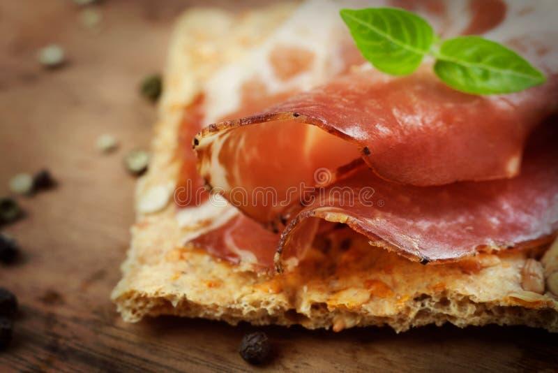 Dried pork collar salami. Ham with herbs royalty free stock photo