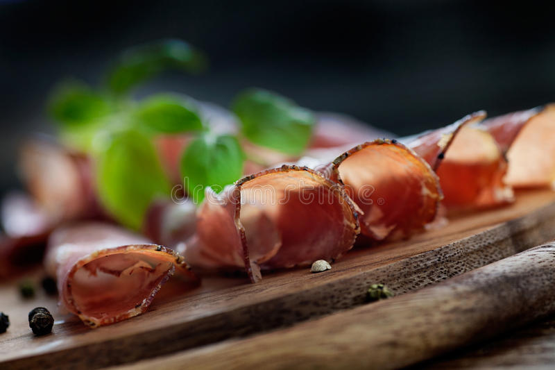 Dried pork collar salami. Ham with herbs stock images