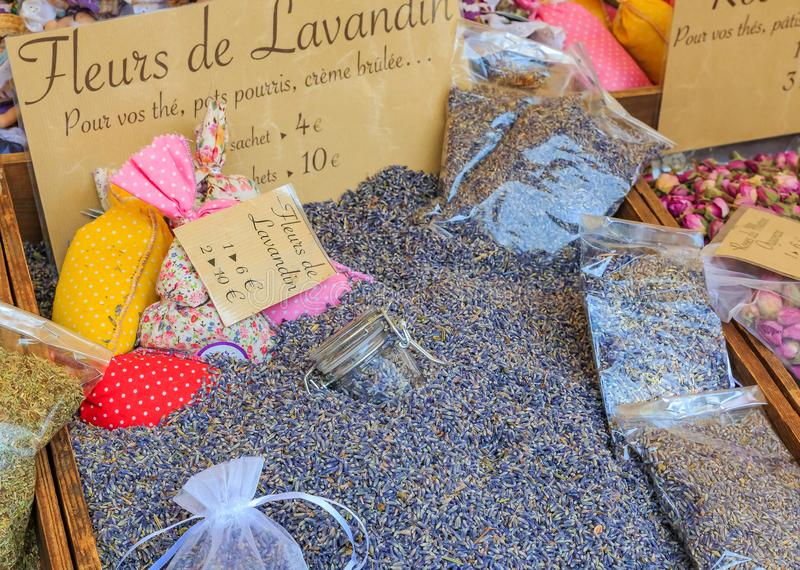 Dried provencal lavender flowers for sale with a handwritten signs at a local outdoor farmers market in Nice, France. Exotic dried provencal lavender flowers for stock photography