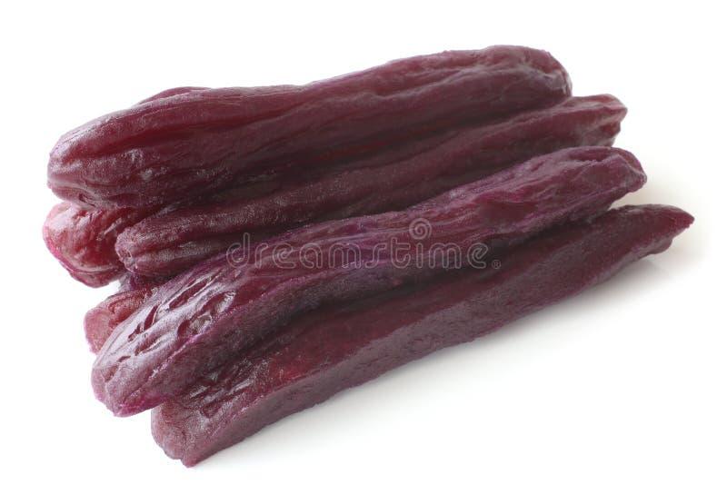 Dried purple sweet potato snacks. On white background stock image