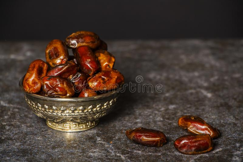 Dried raisins of grapes and dates in a medium-sized cup. stock images