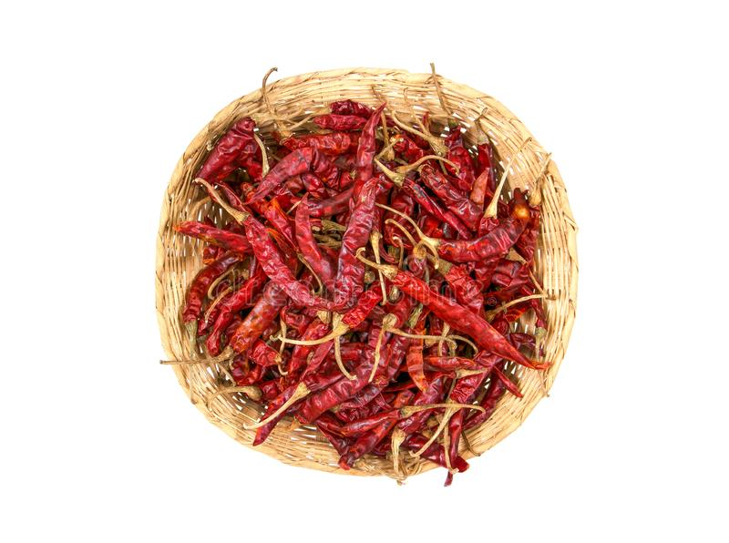 Dried red Chili in bamboo basket isolated on white background. Dried chili in bamboo basket isolated. royalty free stock image