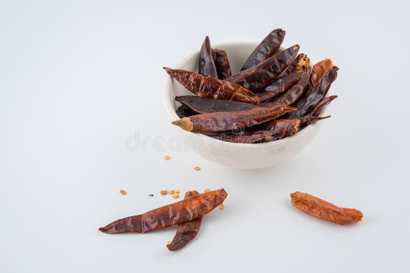Dried red chili or chilli cayenne pepper isolated on white background , red dried chili, food ingredient for spicy cooking royalty free stock images